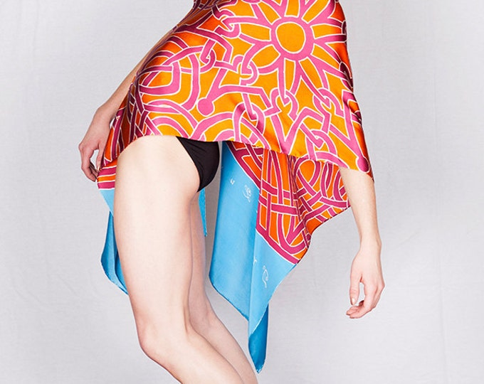 Celtic mandala silk scarf with orange and red pattern.