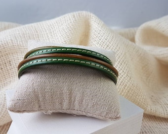 Wrap bracelet made of different leather straps