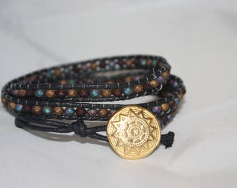 Boho bracelet with opaque crystals and waxed lanyard. Metal button closure
