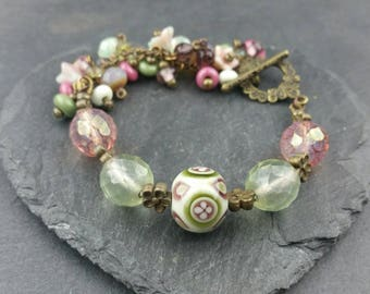 English Garden beautiful pink and green handmade lampwork glass bracelet