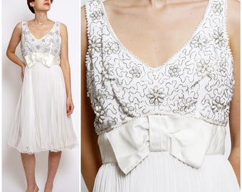 Vintage 60's Elegant White Heavily Beaded Sleeveless Dress with Waist Bow and Pleated Chiffon Skirt by Miss Elliette | Small/Medium
