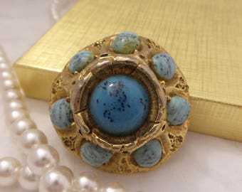 Gold Tone Brooch with Speckled Blue Stones