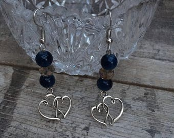 Earrings with glass beads and a double heart charm