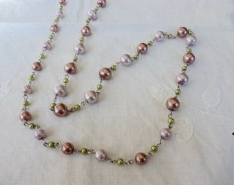 Faux colored pearls strand