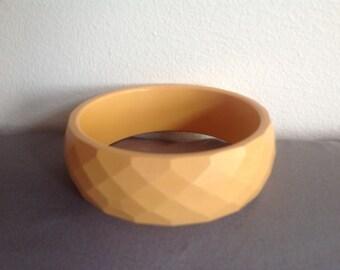 Vintage butterscotch faceted Bakelite bangle bracelet