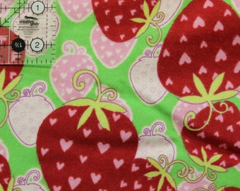 """Big red and pink strawberries on green 100% cotton flannel  41""""-44"""" wide"""