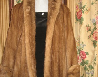 "1950's, 56"" across chest and shoulders, light brown mink caplet, with cuffs"