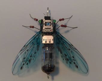 Electronic recycled art blue firefly