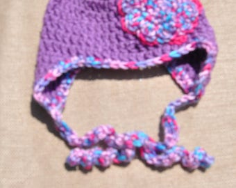 Very cute purple newborn hat with flower applique.