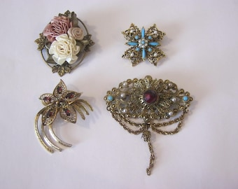 Brooches, 4 vintage goldtone brooches, stones, faux pearls & colored ribbon