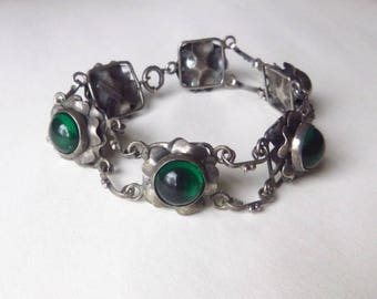 Art Nouveau sterling chunky sectional bracelet with flowers green poured glass cabchon stones