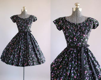 Vintage 1950s Dress / 50s Cotton Dress / Jerry Gilden Black and Purple Floral Dress w/ Ribbon Waist Tie S