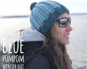 pom pom hat, blue winter hat, crochet winter beanie, blue pom pom hat, pom pom beanie hat winter fashion, winter styles, warm winter hat