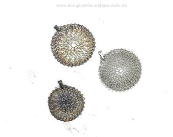 finger knitted stainless steel sun-pendant with stainless steel loop (pure or burnt)