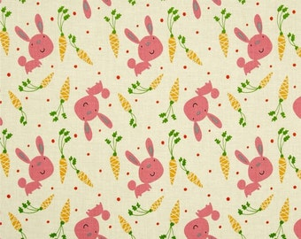 Bunny and Carrots fabric in Pink by David Walker