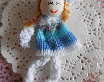 Knitted doll with blue, gray and white striped mats for decoration of 7.50 cm high.