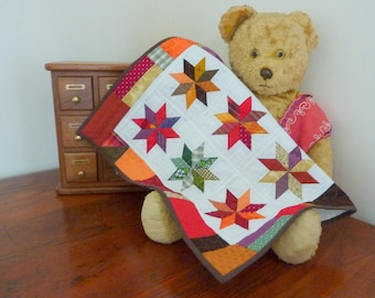 Patchwork Stars Wall Hanging in Warm Reds, Browns, Oranges, Greens, Purple and Mustard - handmade textile art / fiber art