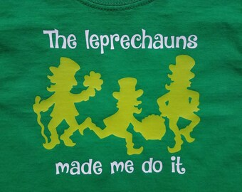 The leprechauns made me do it. St. Patrick's Day. Green. White. st pattys. st pat. leprechaun. vinyl. Boy. Girl. Kids. Tshirt. Little Fawn