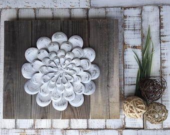 Distressed white flower reclaimed wood