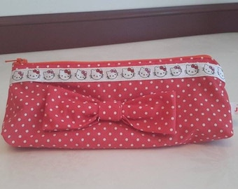 Red cat with bow clutch