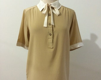 Valentino vintage Italian silk short sleeve tie neck blouse