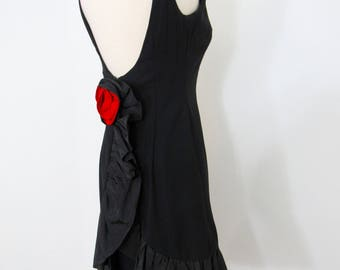 Dramatic 1960s Black Crepe Dress with Taffeta Ruffle Kick Skirt & Plunging Back with Red Rosette