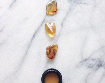 the rains - botanical fragrance - cardamom, mitti attar, fossilized amber - 5g