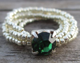 Beaded multi-strand silver ring with green focal bead