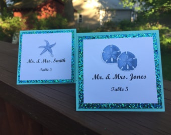 beach wedding sand dollar starfish glitter placecards