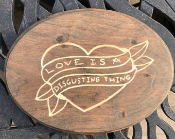 love is a disgusting thing wood carving