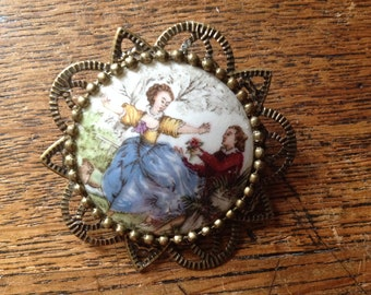 Brooch, antique porcelain Cabochon mounted as a brooch