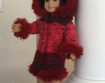 Red Doll Coat , handknit with generous hood and furry trim,in shades of red light to dark ,with a wintry or Holiday look,