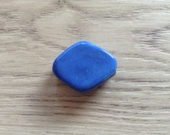 Blue hand shaped ceramic bead