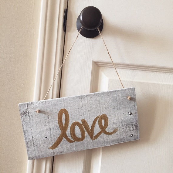 Love Sign in Metallic Gold on White Washed Hanging Sign