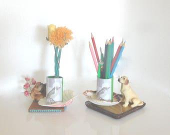 Jars with pencils, vase, bird, centerpiece table decoration