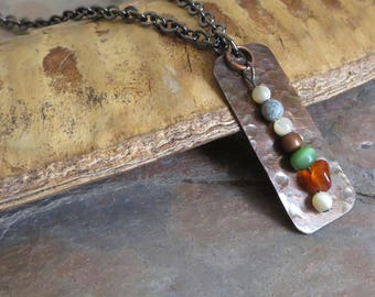 01 - NBX14: Abstract pendant, hammered patina copper, gunmetal chain, beads are glass, carnelian, feldspar, mother-of-pearl, copper, OOAK
