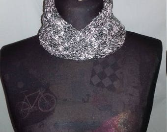 Handmade knitted scarf/cowl, knitted in a soft slub yarn in black and grey tones.
