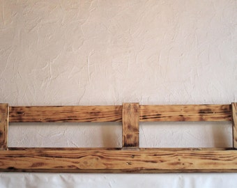 Flamed wooden shelf