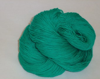 Hand dyed sock wool in bold Malachite 75 SW BFL 25 nylon yarn indie dyed