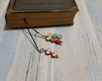 Book thong, bookmark on black waxed cotton cord with polymer clay fruit slice dangles
