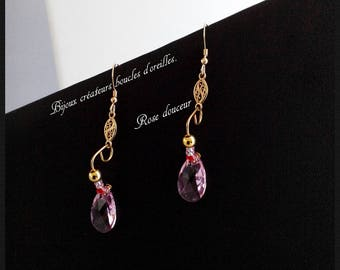 Jewelry designers earrings. Pink softness