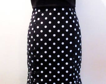 Polka dot black and white fitted dress with peplum at bottom