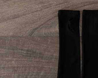 Long black fingerless gloves made from bamboo featuring coloured stitching!