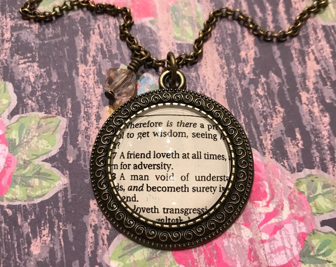 A friend loveth at all times Bible page necklace