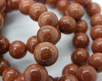 22 natural 8 mm goldstone beads with rust gold powder