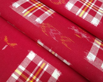 Vintage wool kimono fabric- red with white, yellow and orange abstract kasuri woven pattern- by the yard