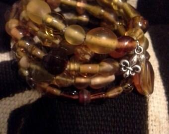 Brown, Topaz Colored Glass Beaded Memory Wire Wrap Bracelet with Fleur de lis Charm