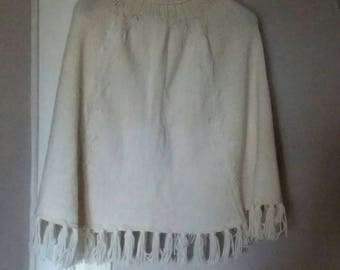 off-white poncho with fringe woman