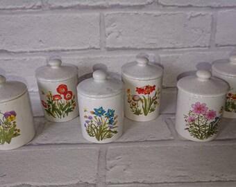 Set of 6 floral trinket pots.