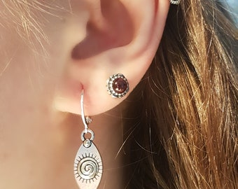 Silver earrings with hanging eyes